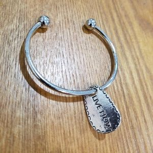 "Jewelry - Silver colored bangle with ""live now"" charm"